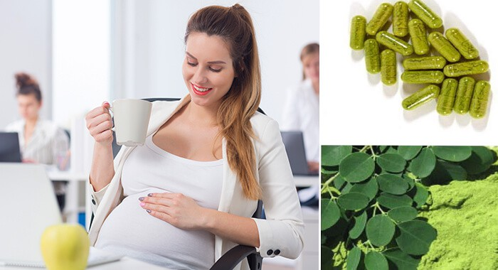 happy pregnant woman drinking moringa capsule
