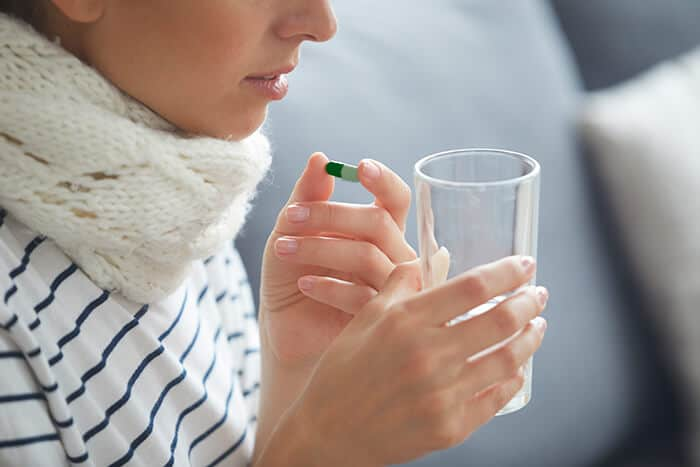 woman with cancer drinking moringa capsule
